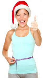 woman Christmas hat measuring tape