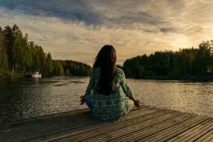 yoga woman lake woods boat