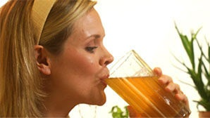 woman drinking nourish