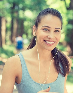 girl running headphones