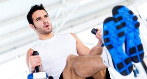 man on rowing machine gym
