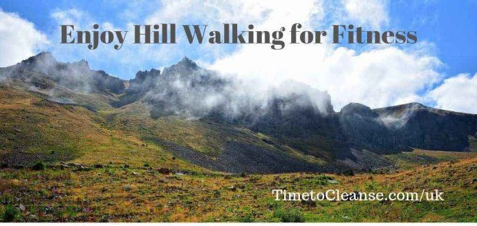 mountains with clouds and a meadow with enjoy hill walking for fitness banner