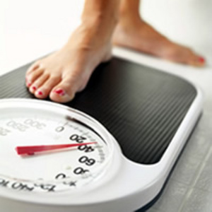 scales with womans foot