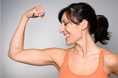 woman flexing arm muscles