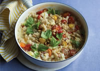Savory oats with brie and cherry tomatoes