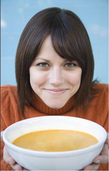 lady eating wild mushroom flavor soup