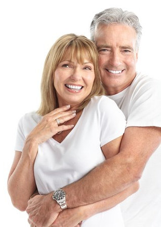 older healthy couple holding hands