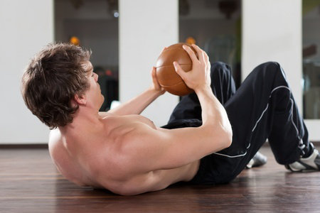 man holding gym ball