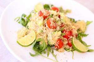 Quinoa salad with tomatoes and limes