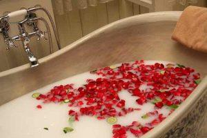 bathtub with flowers floating
