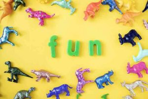 plastic animals and letters spelling fun